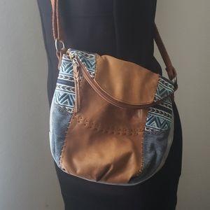 The Sak crossbody leather and denim bag